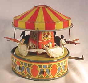 Tin Windup Toy: Carousel and airplane ride
